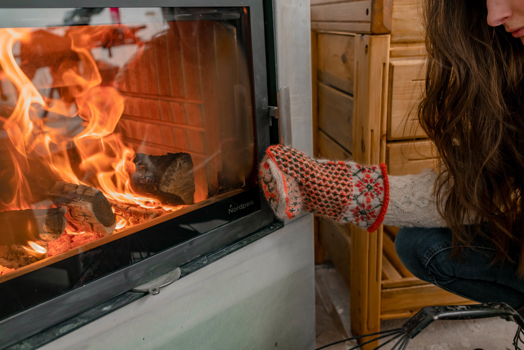 Warming Hands With Mittens On Fireplace - Winter Cozyness
