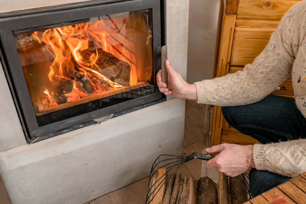 Opening Fireplace To Set More Fire With Wood