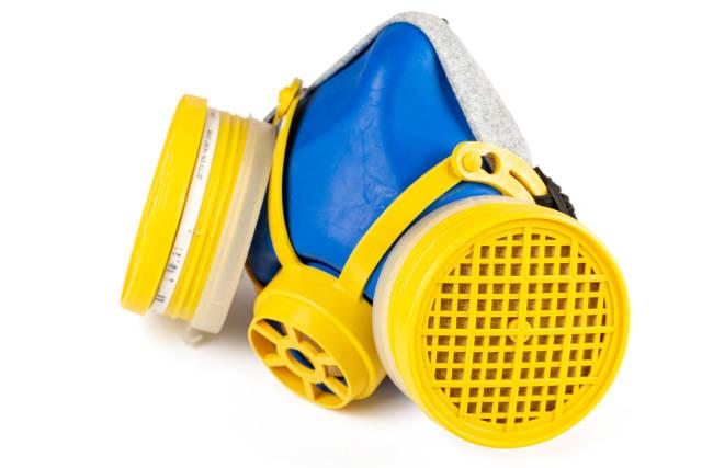Blue-yellow respirator mask on white