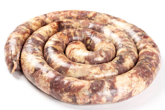 Raw homemade sausage on white background