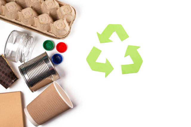 Different types of garbage and recycling sign, top view, concept of nature conservation, separation and sorting of garbage