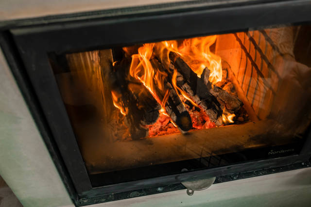 Warm Light From Flames In Fireplace With Wood