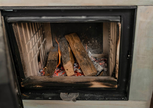 Fireplace With Wood And Flames