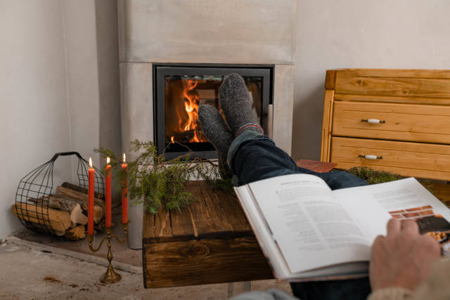 Reading Book White Resting Feet Near Fireplace