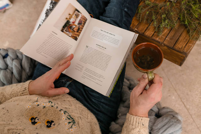 Reading Book And Drining Tea Cozy Winter Mood