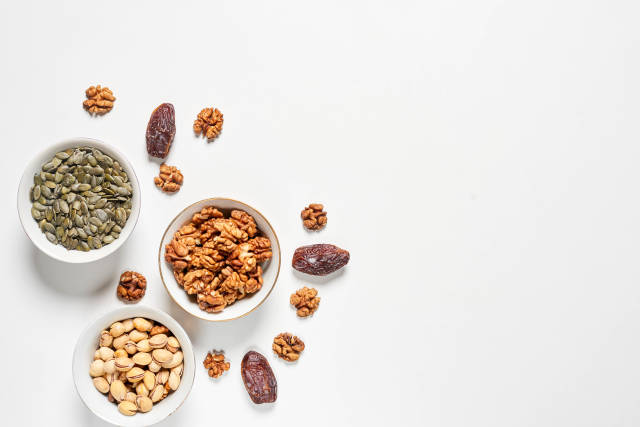 Various nuts and dried fruits on white background