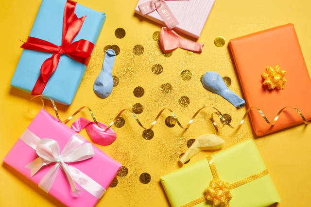 Birthday gifts on yellow background