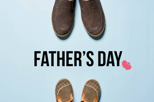 Fathers day concept - Fathers boots and babys shoes