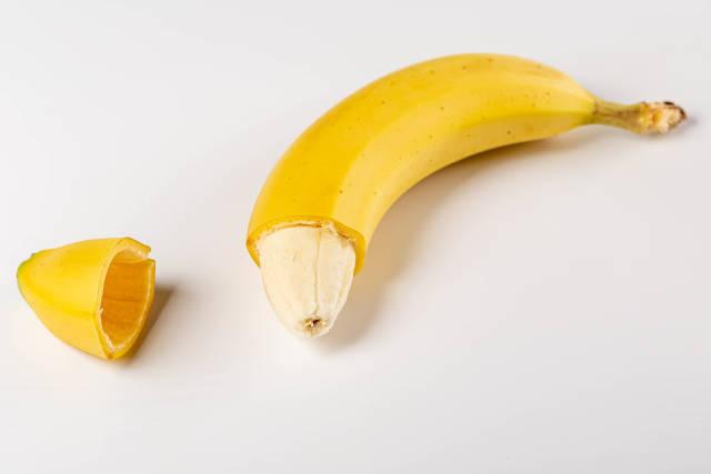 Yellow banana with no peel at the tip