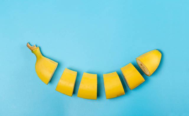 Sliced ripe banana on a blue background