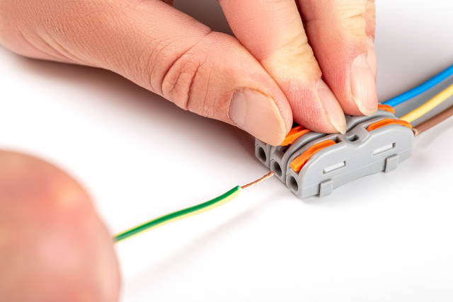 Wire connector with electric wires and mens hands