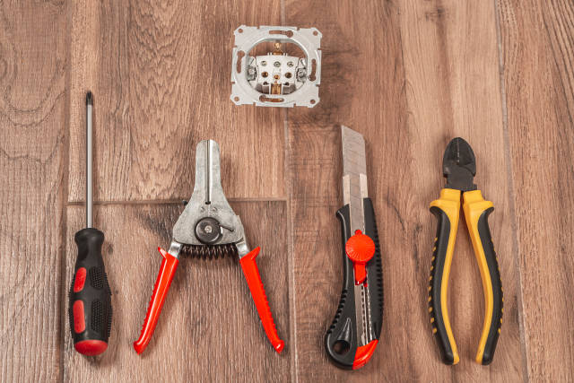 Tool set and socket on floor background, top view