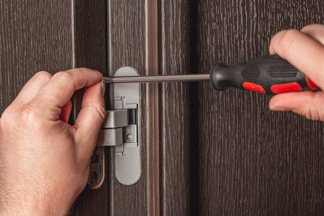 Screw tightening with a screwdriver, installation of furniture hinges for doors