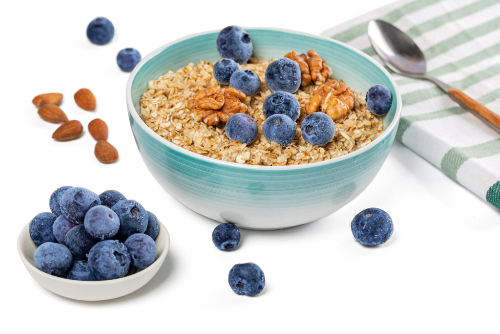Oatmeal for breakfast, healthy food and diet concept