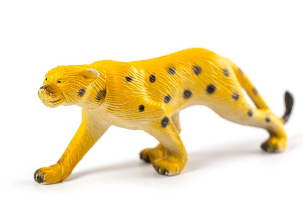 Childrens cheetah toy on white background