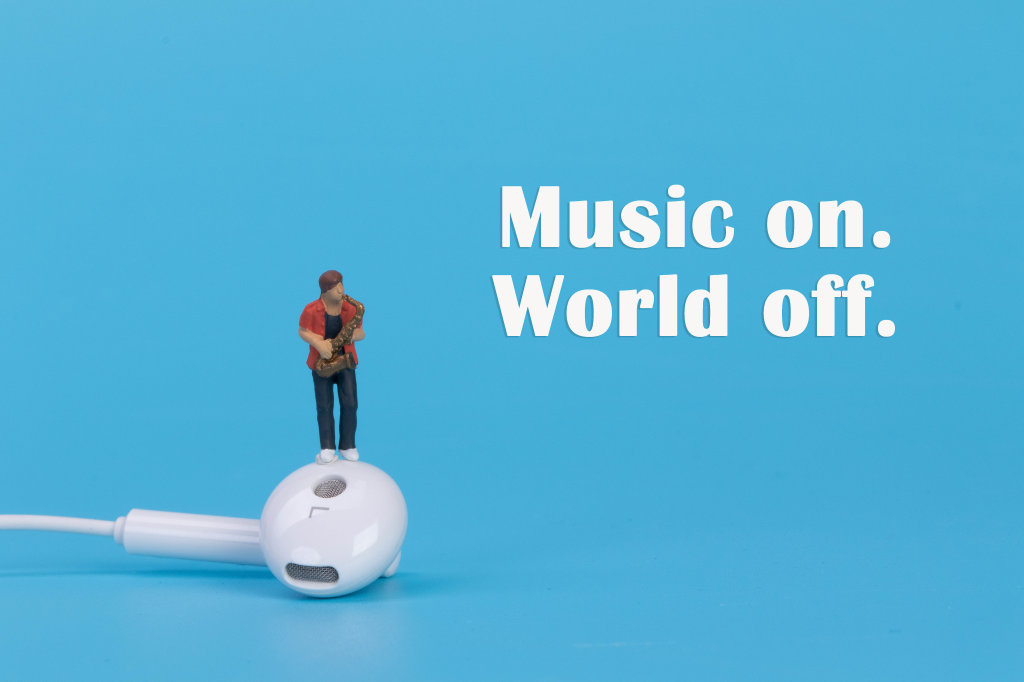 Miniature musician with earbud and Music on World off text