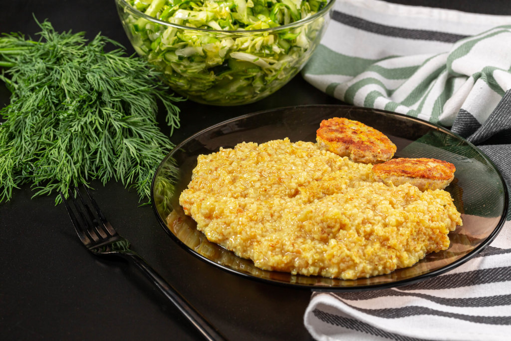 Wheat porridge with cutlets and salad