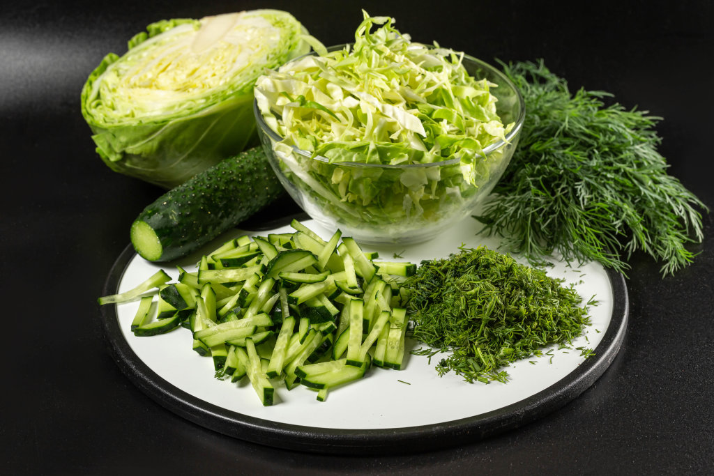 Bowl of healthy salad with ingredients