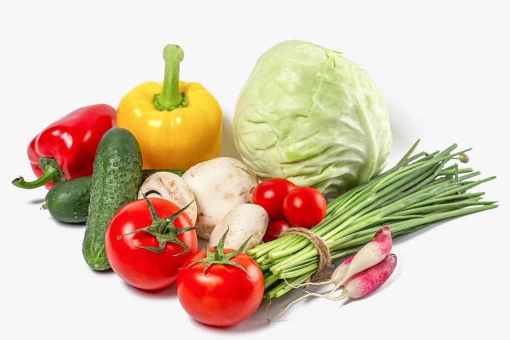 Spring fresh vegetables on white background