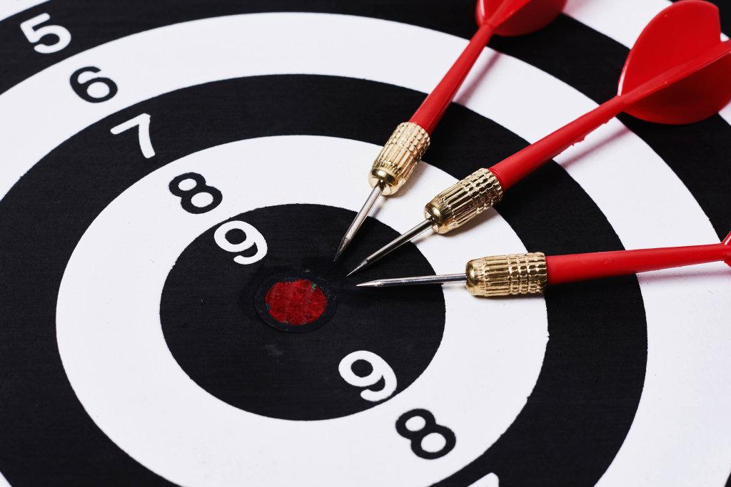 Three darts on dart board