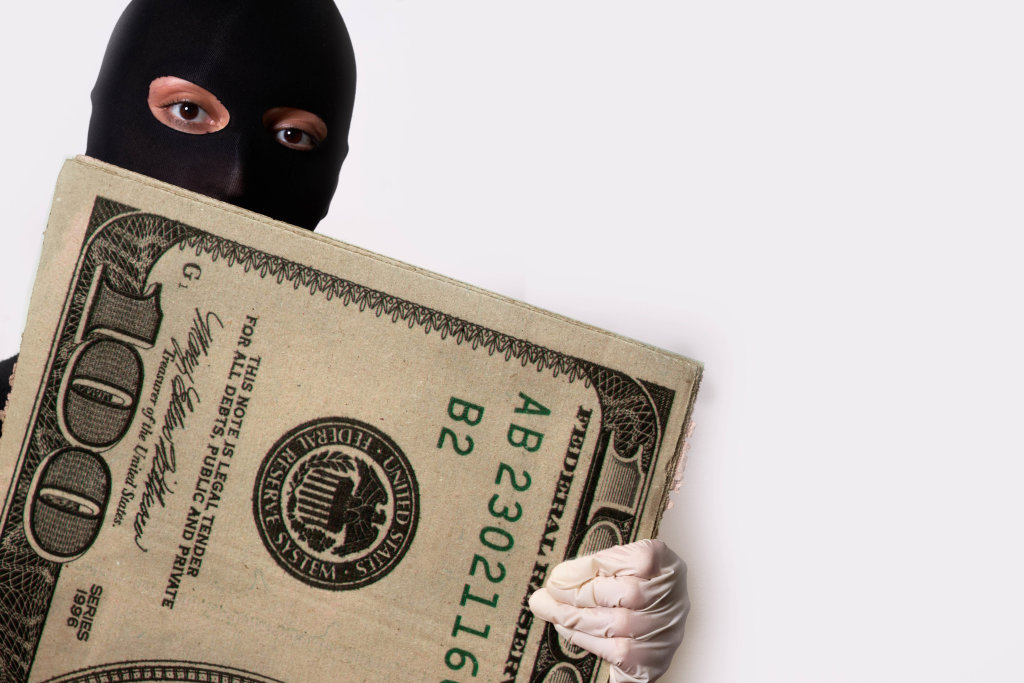 Robber showing stolen money