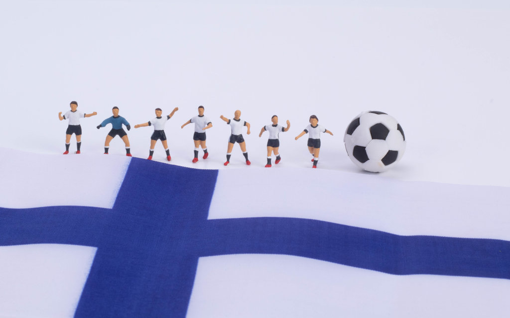 Football players and flag of Finland