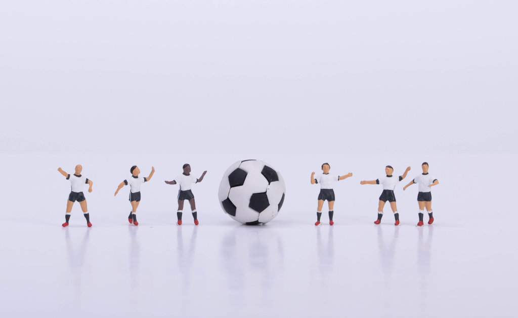 Football players and ball on white background