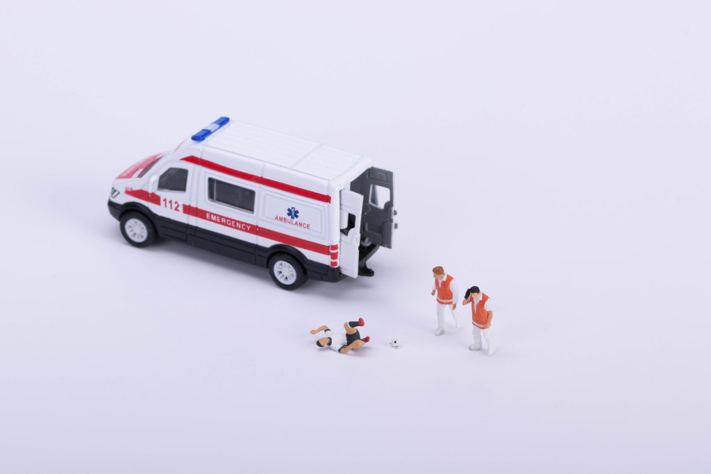 Ambulance and injured soccer player