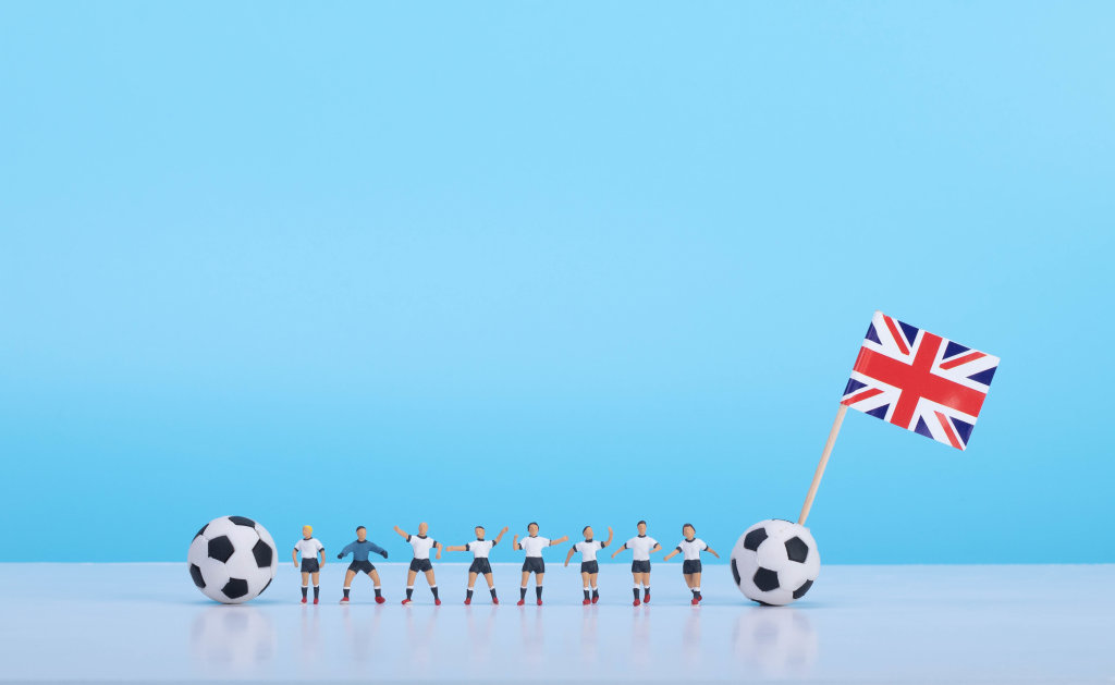Soccer players with flag of United Kingdom