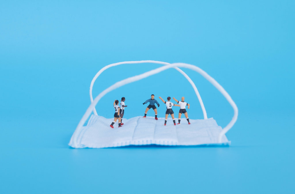 Soccer players on medical face mask