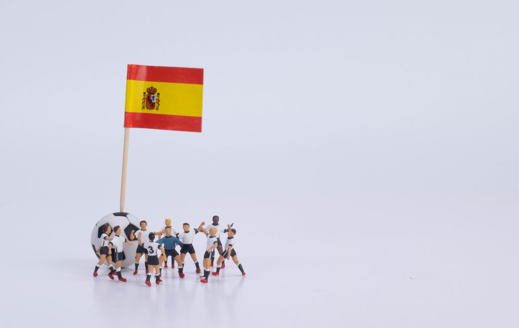 Flag of Spain and group of football players