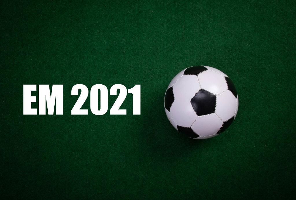 Soccer ball and EM 2021 text on green grass