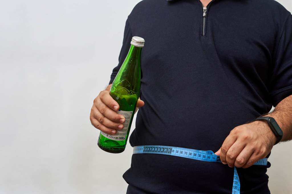 Male has alcohol and weight problems