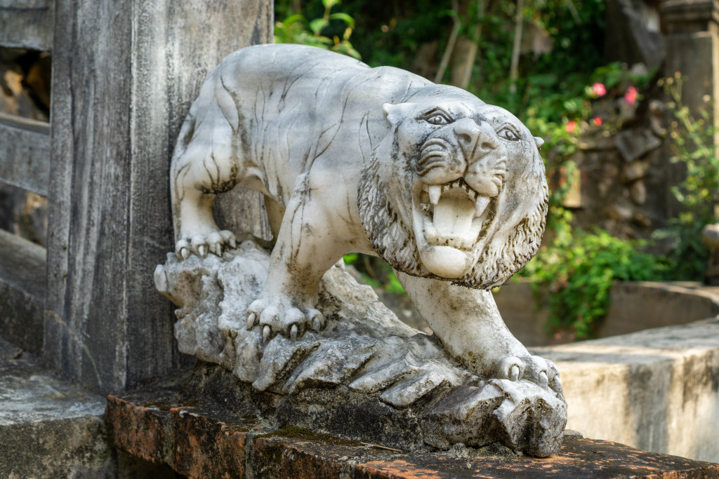 White Tiger Statue on the Beginning of a Wooden Bridge at the Marble Mountains in Danang, Vietnam