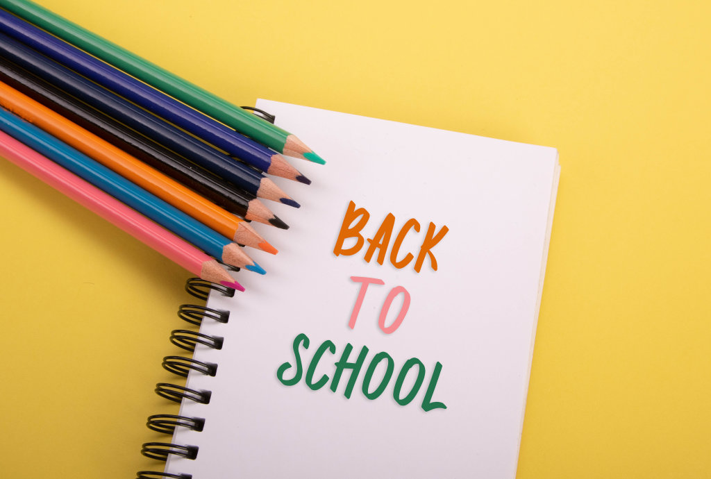 Colored pencils and notebook with Back to School text
