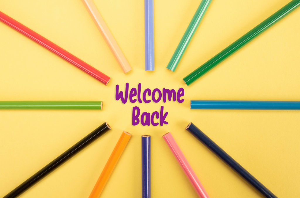 Colored pencils with Welcome Back text on yellow backgorund