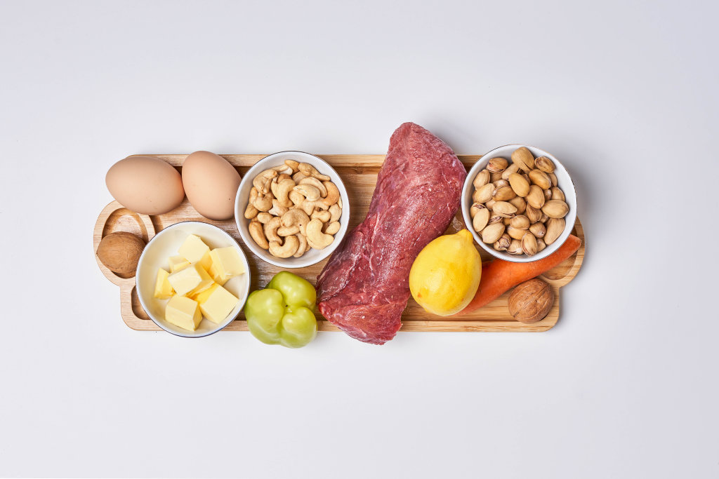 A set of healthy food - meat, nuts, protein, vegetables and fruits on white background. Top view