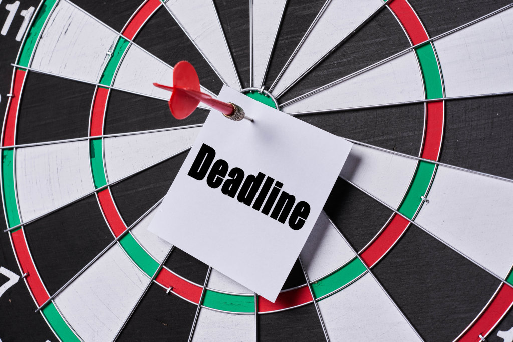 Dart arrow hitting deadline note