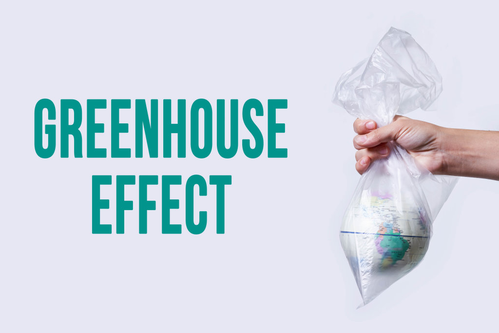 Hand holds globe in the plastic bag - greenhouse effect