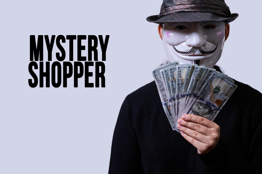 Anonymous person holds a pile of money. Mystery shopper