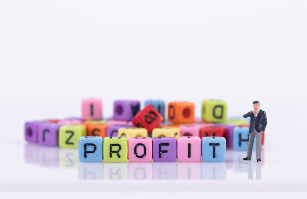 Businessman with colorful toy blocks with Profit text