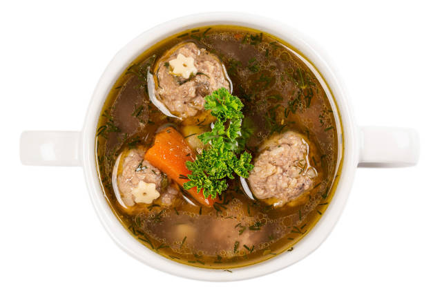 Soup with meatballs, potato and carrots, top view
