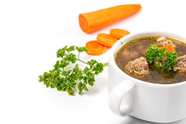 Meatball soup with vegetables and fresh parsley