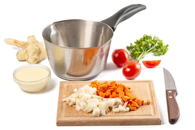 Sliced jerusalem artichoke and carrots, cooking process