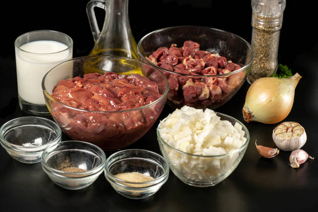 Raw ingredients for making pate on dark background