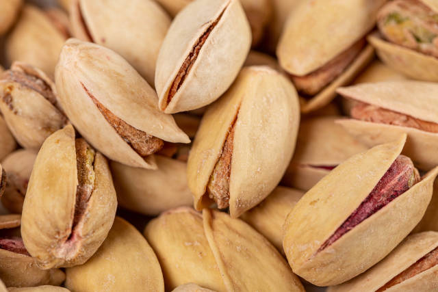 Roasted and salted pistachios with shell, background