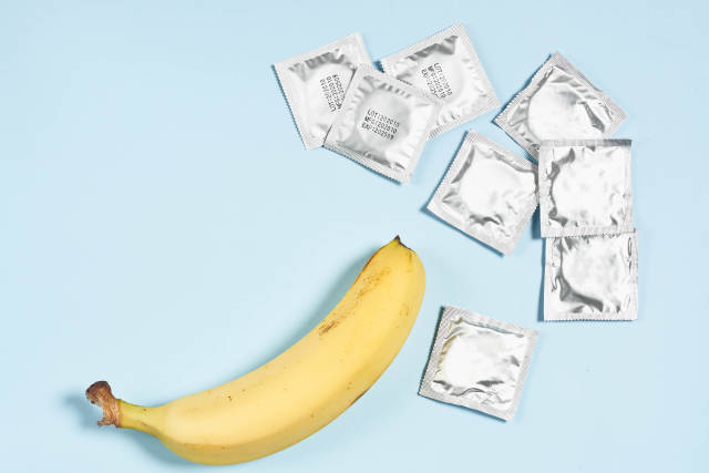 A banana and pile of condoms