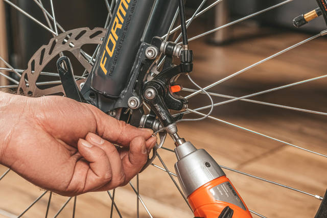 Installing brakes on a bicycle wheel