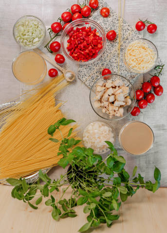 Table Flatlay Set With Chicken Spagetti Ingredients Recipe