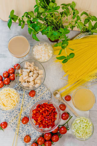Table Flatlay Set With Chicken Spagetti Ingredients